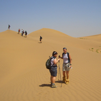 people treking in the Sahara